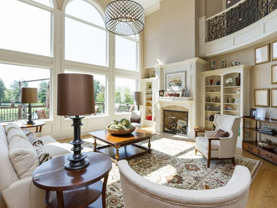 The living room of this $2M Carmel home features views of Pete Dye Championship Golf Course