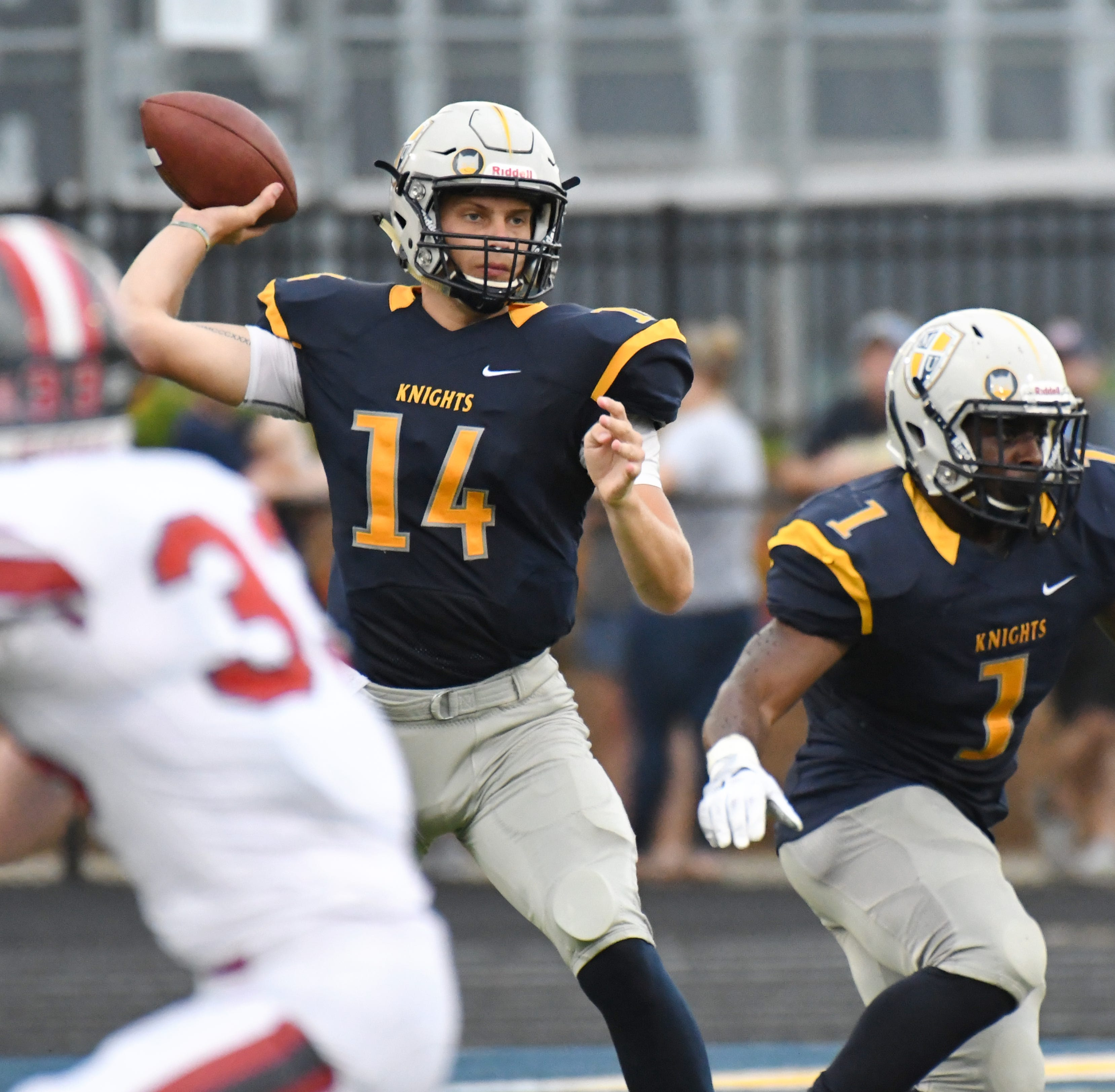 Marian University quarterback Luke Johnston winds up to pass.