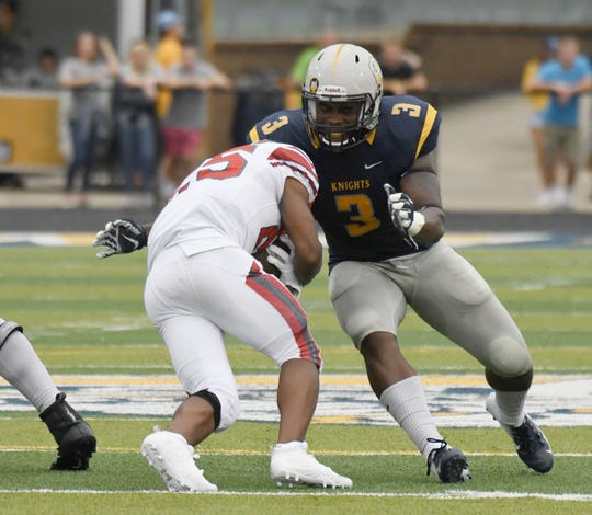 Marian University linebacker Nickai Poyser attempts to make a tackle.