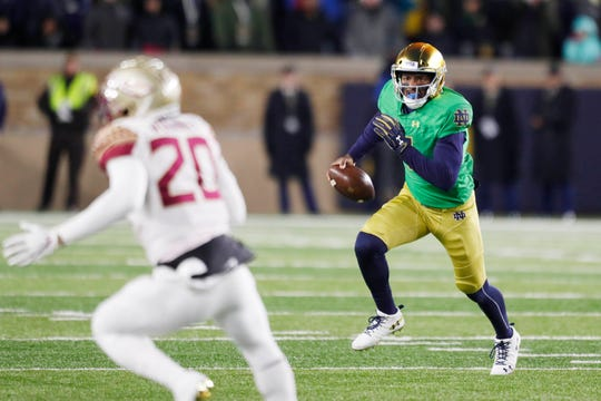 Notre Dame Fighting Irish quarterback Brandon Wimbush (7) scrambles out of the pocket against the Florida State Seminoles during the first quarter at Notre Dame Stadium.