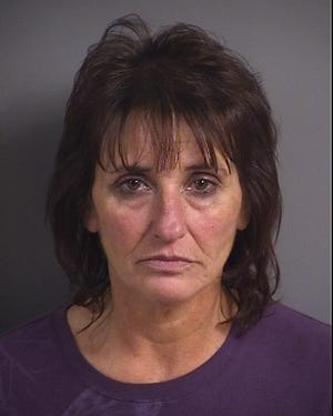 Bonnie Jean Kinney, 53, is being held in the Johnson County Jail on a domestic abuse assault charge issued Nov. 15.