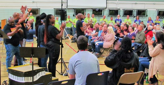 On Monday, Nov. 12 Soweto Choir members rocked the house during a session with the Oakdale Community Choir at what is informally known as the Oakdale Prison in Coralville.