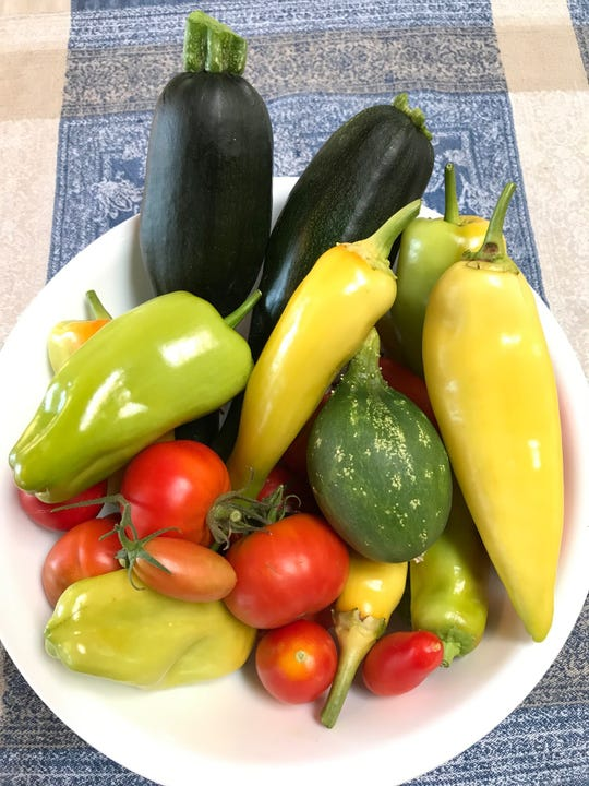 Sweet peppers, cucumbers and tomatoes are among the bounty of Morrell's New Mexico garden.