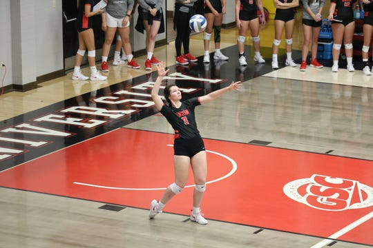 Audrey Cagle serves during a game for Union volleyball this past season.