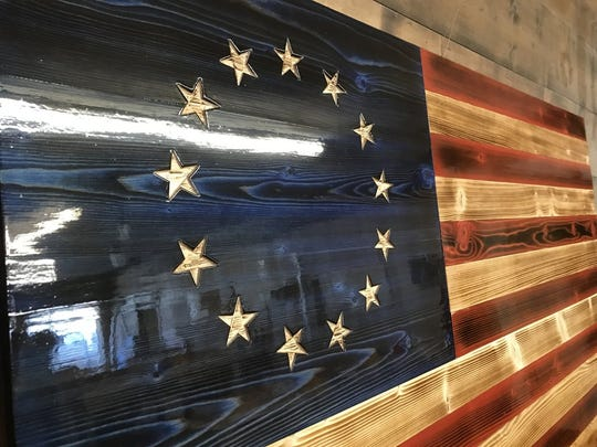 The Charred Betsy is a rustic interpretation of the original flag of the 13 colonies.