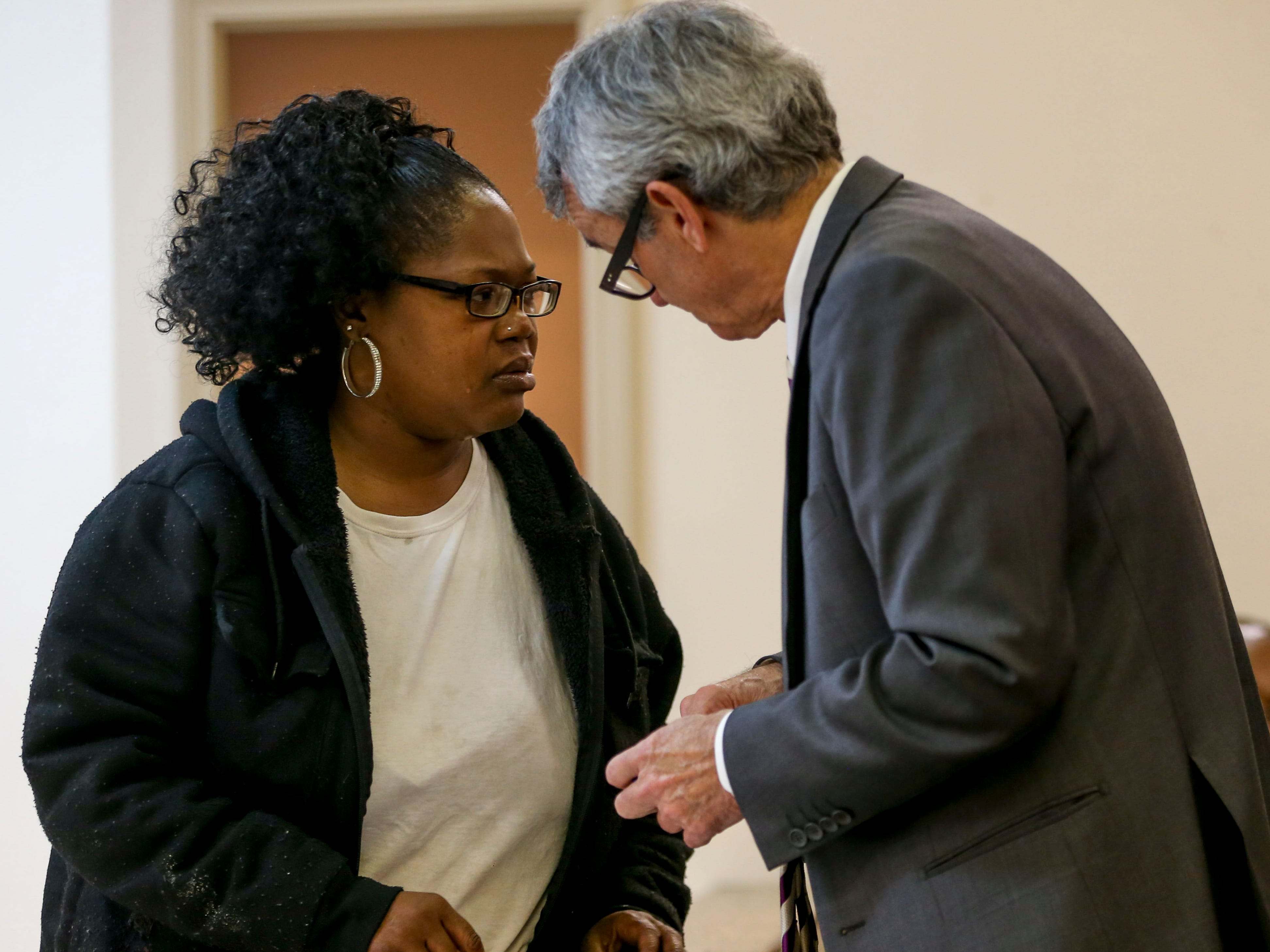 Alicia Hassell speaks with assistant district attorney mike Mosier at a court appearance for Keon Stewart at Jackson City Court in Jackson, Tenn., on Thursday, Nov. 15, 2018.