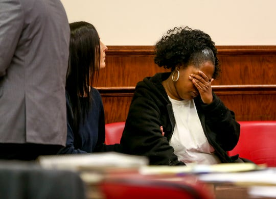 Alicia Hassell covers her eyes with her hand while Keon Stewart is led out of the court room with his hearing being pushed back a month at a court appearance for Stewart at Jackson City Court in Jackson, Tenn., on Thursday, Nov. 15, 2018.