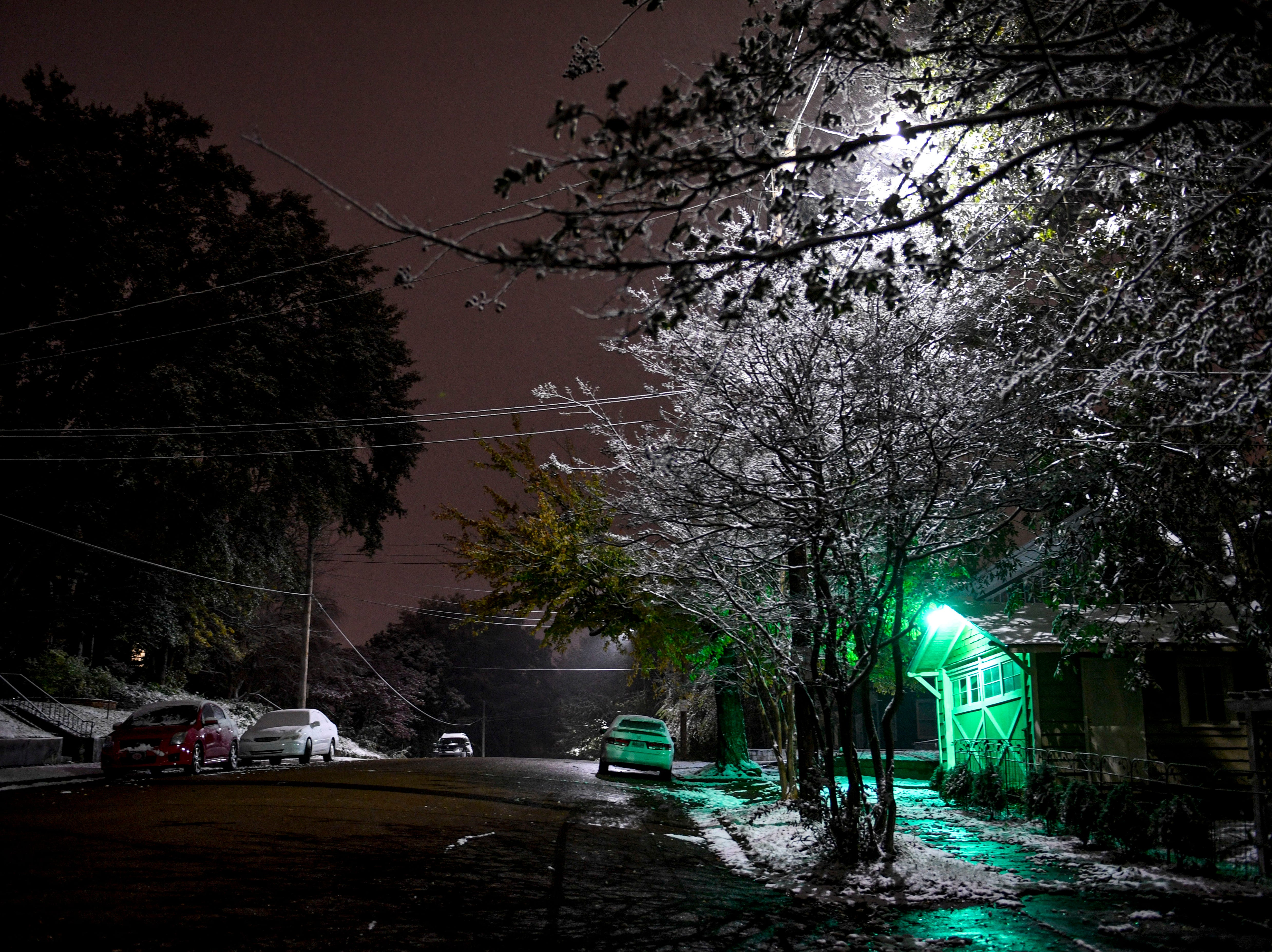 An early snowfall coated scenes of late changing fall leaves, streets, and downtown with powdery snow in Jackson, Tenn., on Wednesday, Nov. 14, 2018.