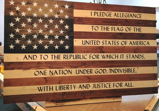 Pledge of Allegiance flag features hand painted script on American spruce.