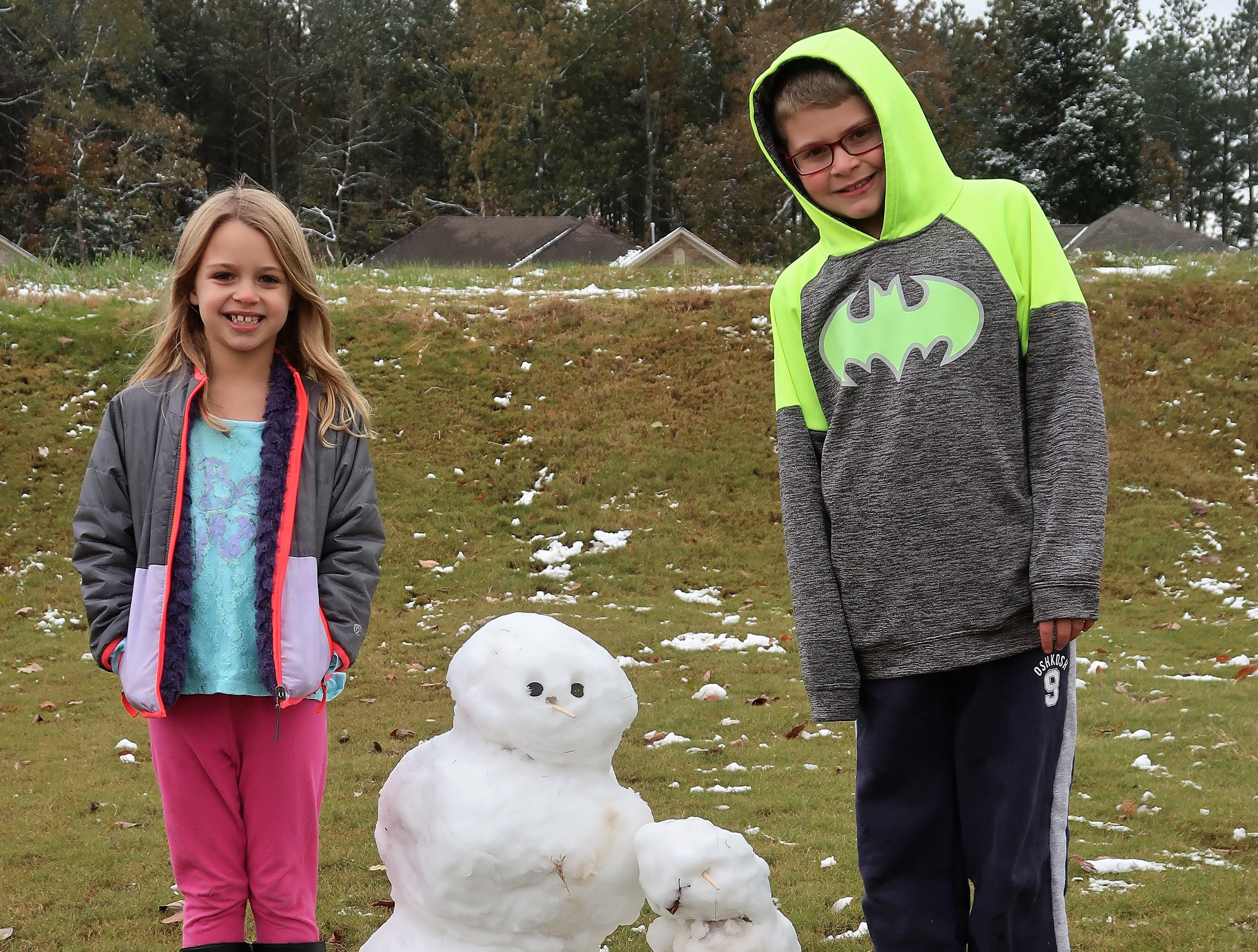 Luci Lutrell and Parker Lutrell played in the snow and built a snowman while having a day off from school on Thursday, November 15, 2018.