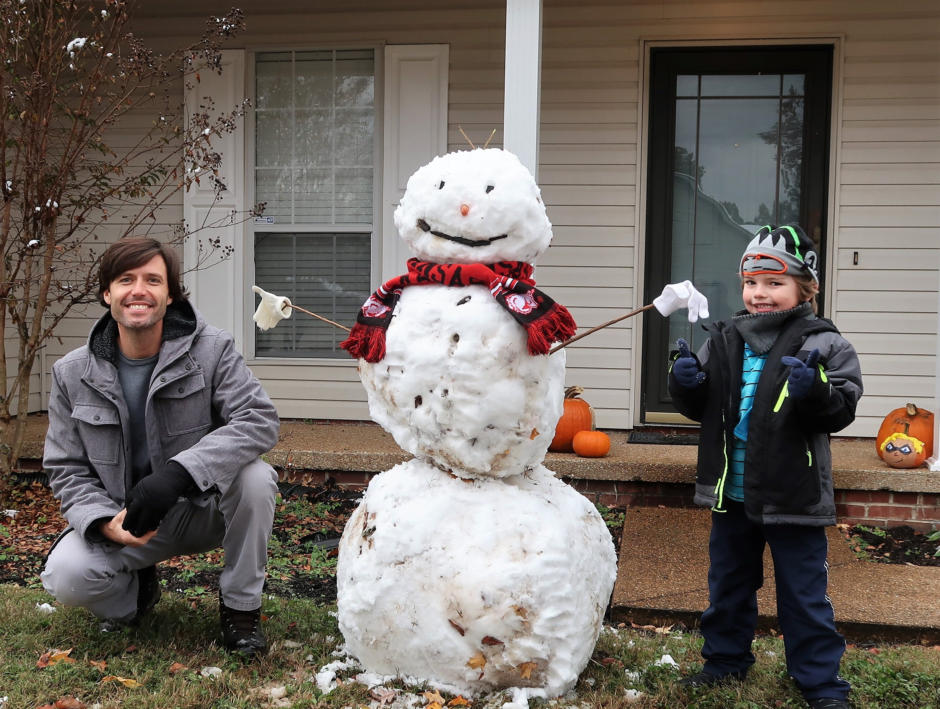 Brian Betts and his son, Luke, posed by the snowman they built on Thursday while enjoying playing in the unusual snow that fell  in West Tennessee on Wednesday night, November 14, 2018.