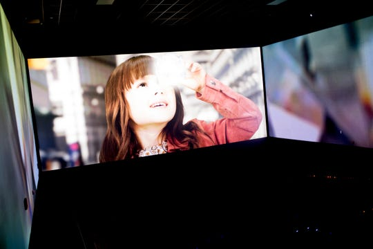 A trailer plays inside the ScreenX theatre at Regal Pinnacle Cinema Turkey Creek in Knoxville, Tennessee on Thursday, November 15, 2018. ScreenX gives a panoramic view using five movie projectors and is only one of ten theaters nationwide to feature the new technology.