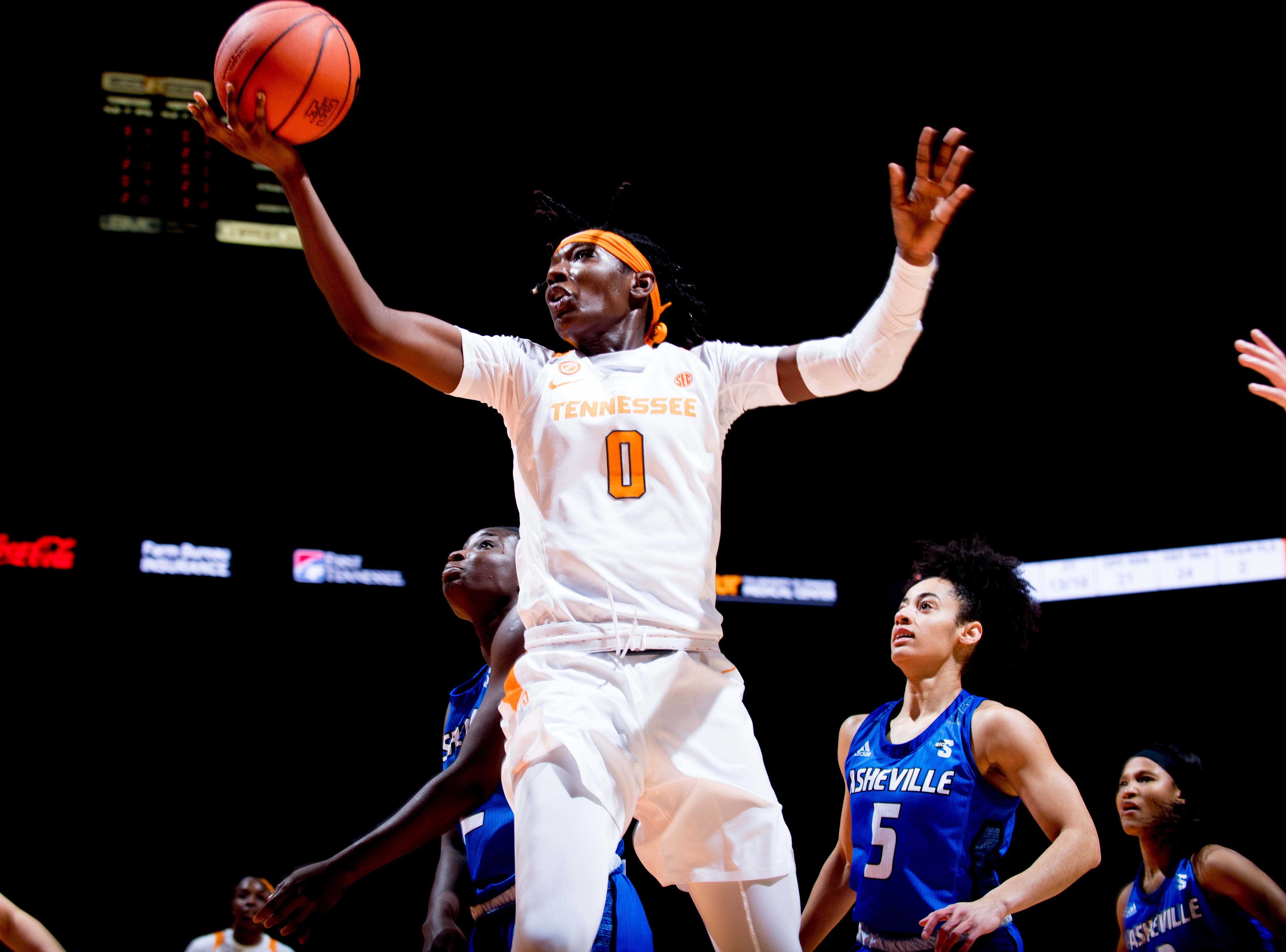 Tennessee guard/forward Rennia Davis (0) shoots a layup during a game between Tennessee and UNC Asheville at Thompson-Boling Arena in Knoxville, Tennessee on Wednesday, November 14, 2018.