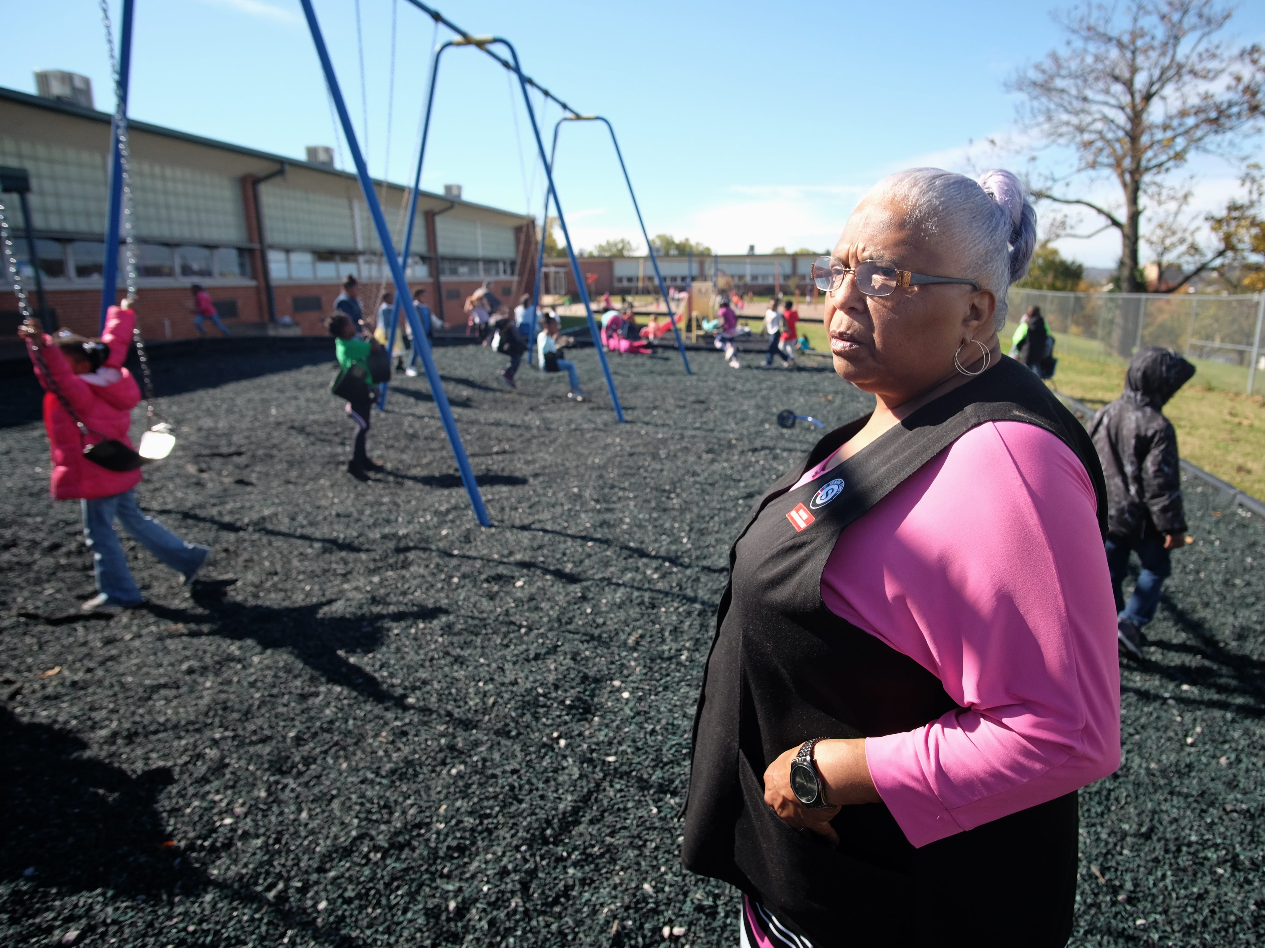 Foster Grandparent Lena Morrison watches over her kindergartners during recess at Green Magnet Academy on Wednesday, November 7, 2018 in Knoxville. Morrison has been serving as a Foster Grandparent along with her sister Hattie Crockett for three years in Knoxville.