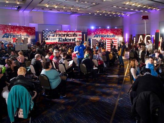 People auditioning along with their friends and family wait in the holding room during America's Got Talent auditions held at the Knoxville Convention Center on Thursday.