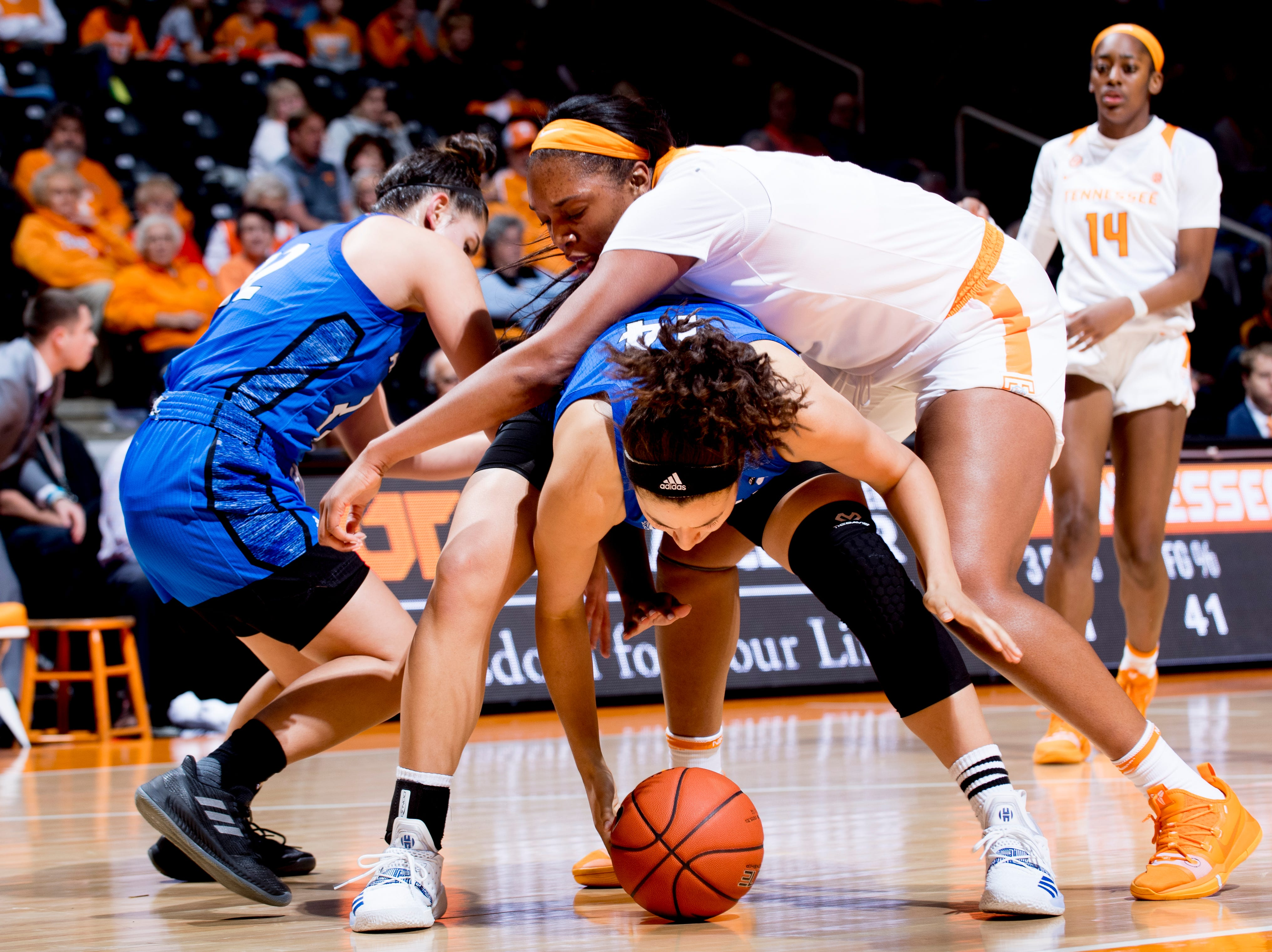 Tennessee center Kasiyahna Kushkituah (11) runs into UNC Asheville  center Brooke Jordan-Brown (14) and UNC Asheville  forward Juliet Esadah (12) during a game between Tennessee and UNC Asheville at Thompson-Boling Arena in Knoxville, Tennessee on Wednesday, November 14, 2018.