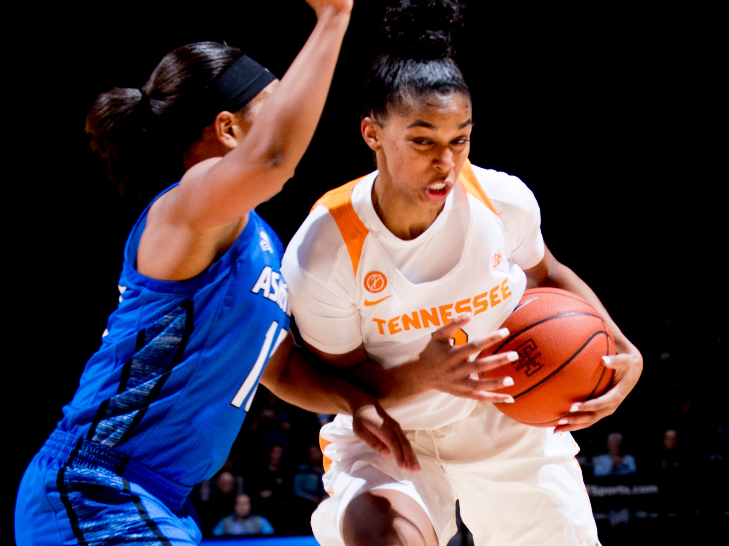 Tennessee guard Evina Westbrook (2) tries to power past UNC Asheville  guard Jimeshia Lawson (11) during a game between Tennessee and UNC Asheville at Thompson-Boling Arena in Knoxville, Tennessee on Wednesday, November 14, 2018.