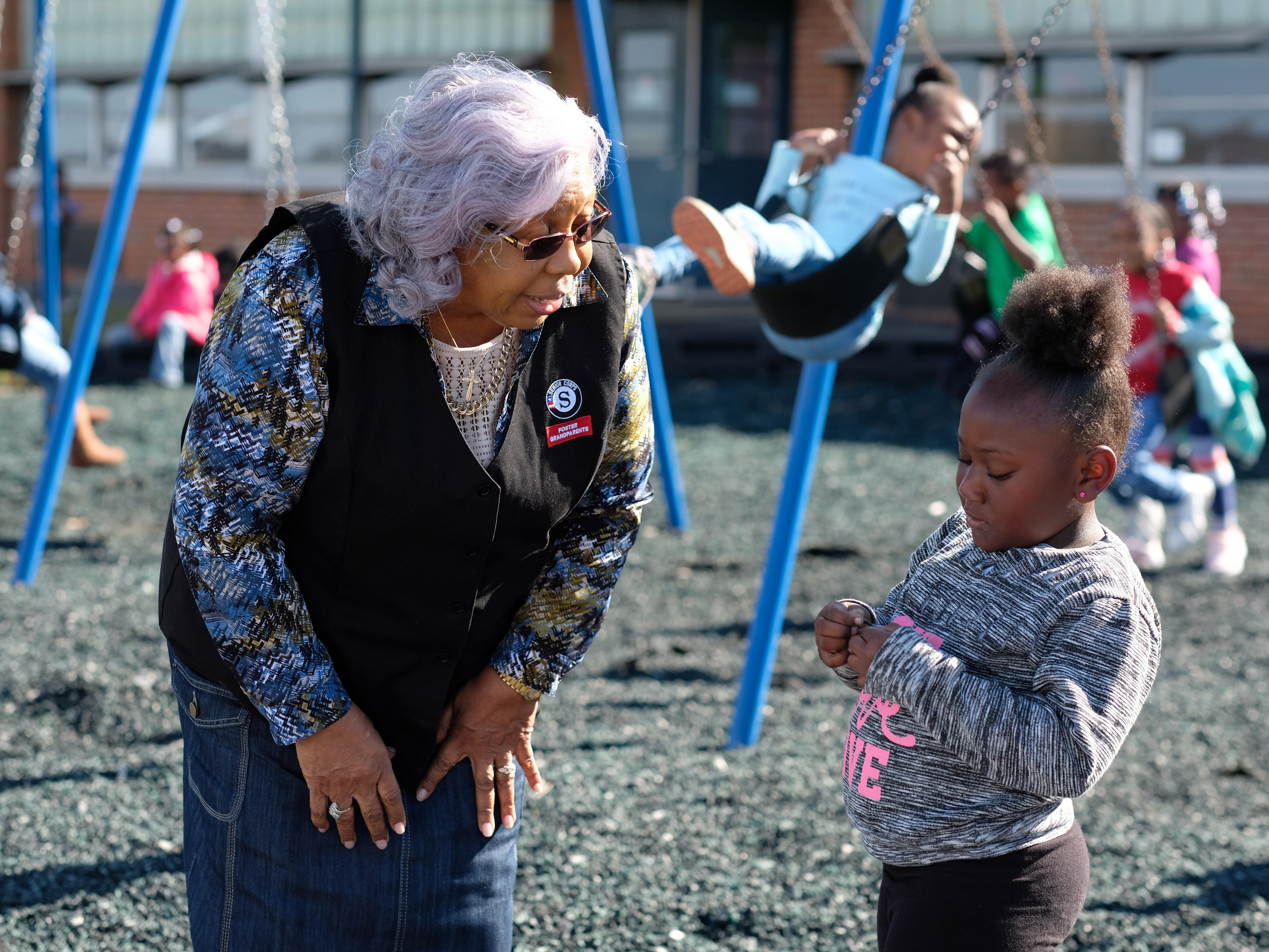 Foster Grandparent Hattie Crockett speaks with kindergartner Camilya Wolble during recess at Green Magnet Academy on Wednesday, November 7, 2018 in Knoxville. Crockett has been serving as a Foster Grandparent along with her sister Lena Morrison for three years in Knoxville.