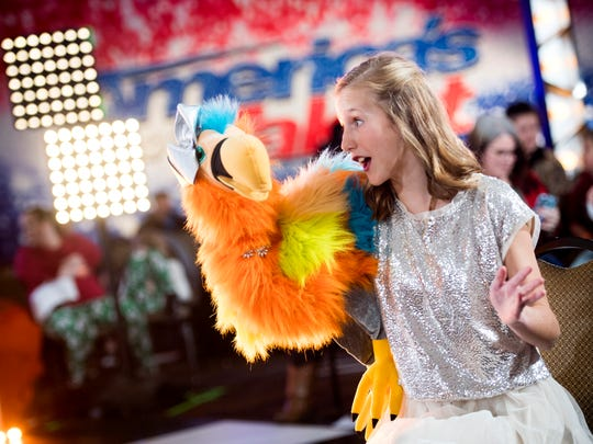 Claire Patterson, 13, and her puppet Cora perform for the film crew in the holding room during America's Got Talent auditions held Thursday at the Knoxville Convention Center.