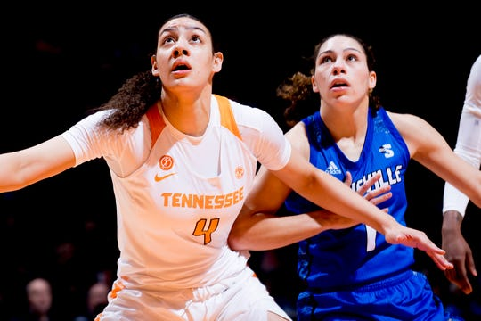 Tennessee forward Mimi Collins (4) and UNC Asheville  guard Amaryah Corpening (1) eye the rebound during a game between Tennessee and UNC Asheville at Thompson-Boling Arena in Knoxville, Tennessee on Wednesday, November 14, 2018.