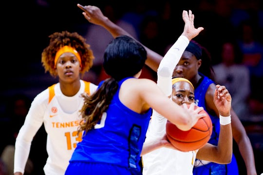 UNC Asheville  forward Alexis Toney (5) is defended by Tennessee guard Zaay Green (14) during a game between Tennessee and UNC Asheville at Thompson-Boling Arena in Knoxville, Tennessee on Wednesday, November 14, 2018.