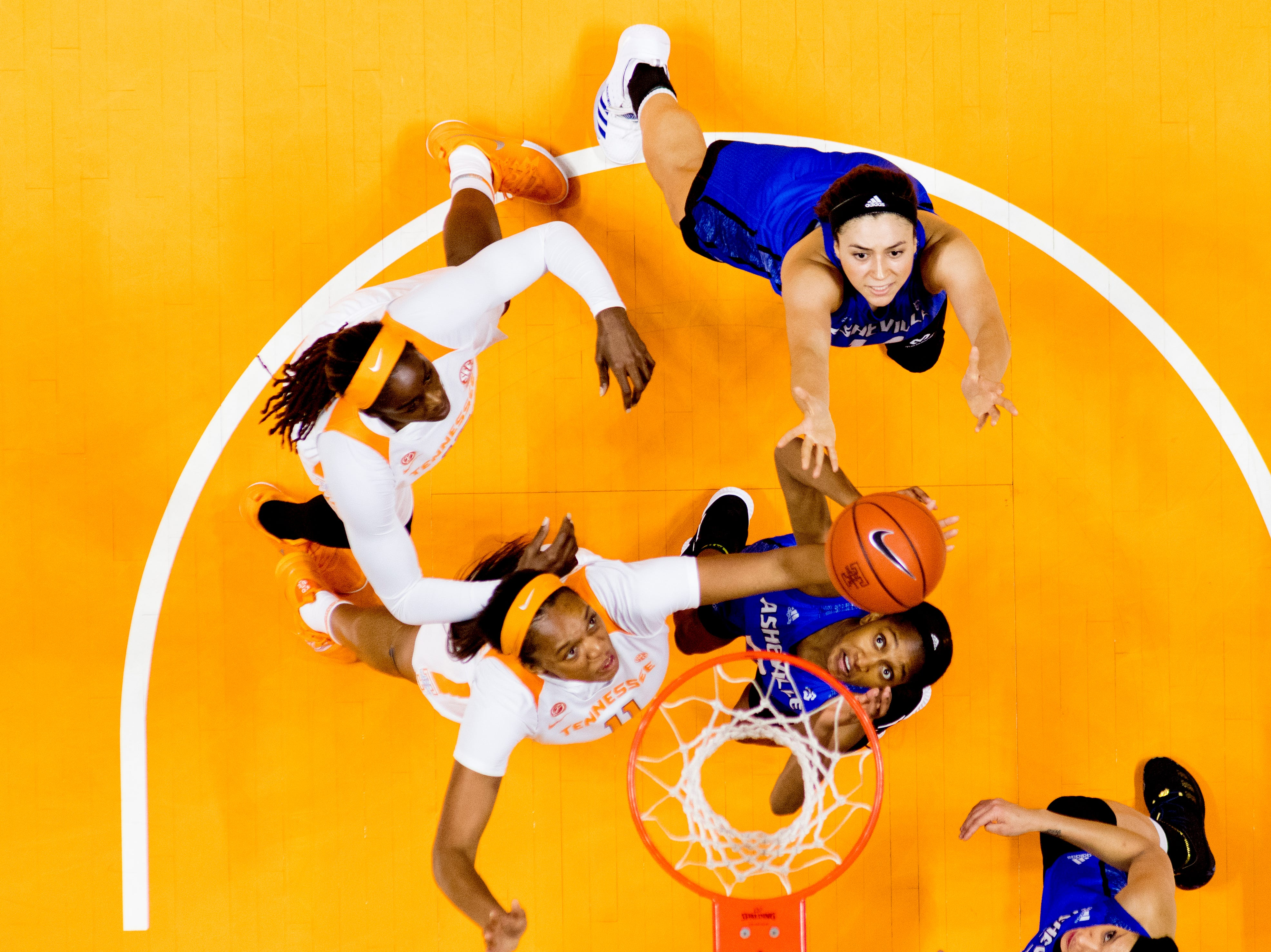 Tennessee center Kasiyahna Kushkituah (11) and UNC Asheville  guard Nadiria Evans (0) reach for the rebound during a game between Tennessee and UNC Asheville at Thompson-Boling Arena in Knoxville, Tennessee on Wednesday, November 14, 2018.