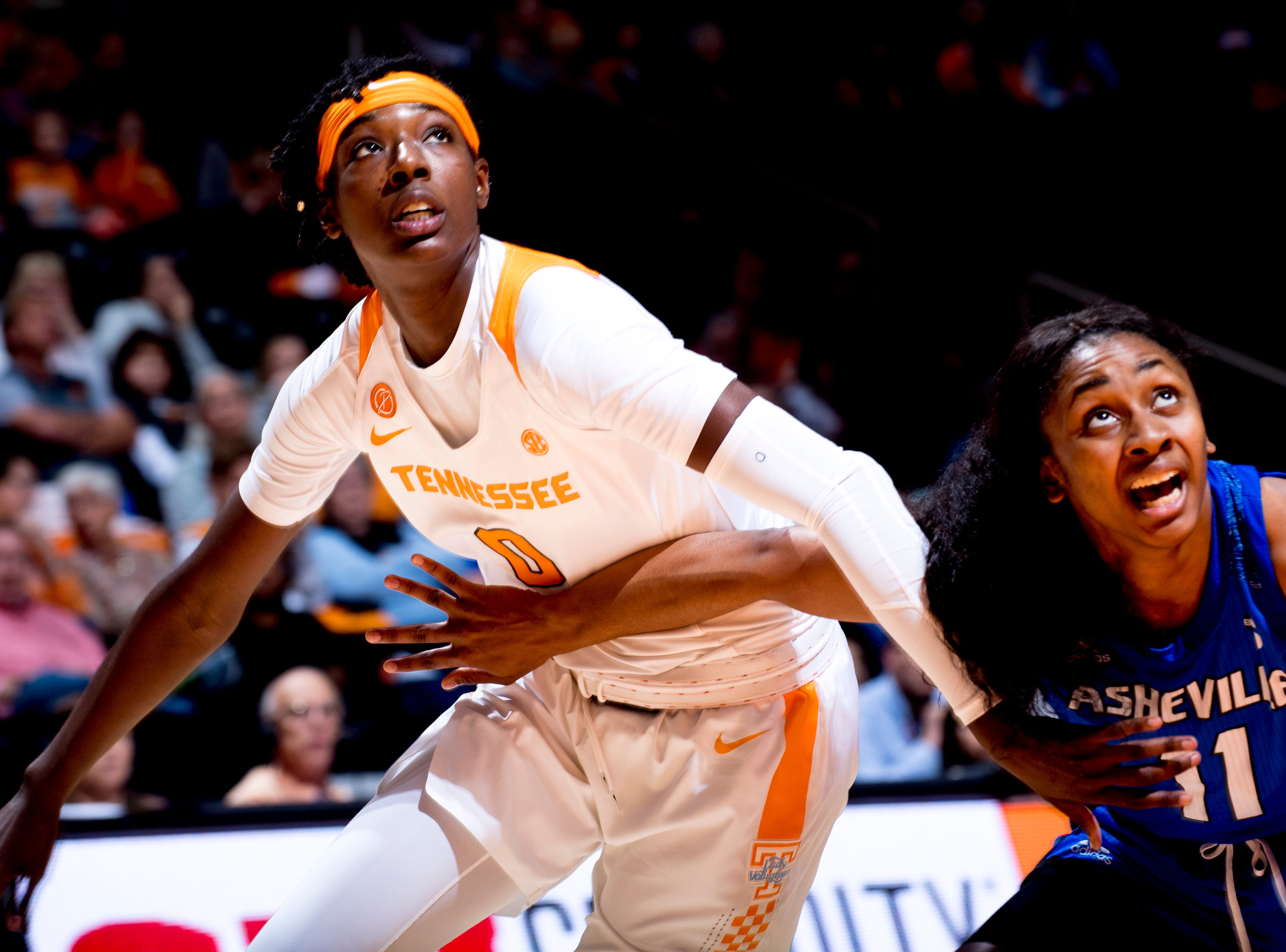 Tennessee guard/forward Rennia Davis (0)  and UNC Asheville  guard Jimeshia Lawson (11) eye the rebound during a game between Tennessee and UNC Asheville at Thompson-Boling Arena in Knoxville, Tennessee on Wednesday, November 14, 2018.