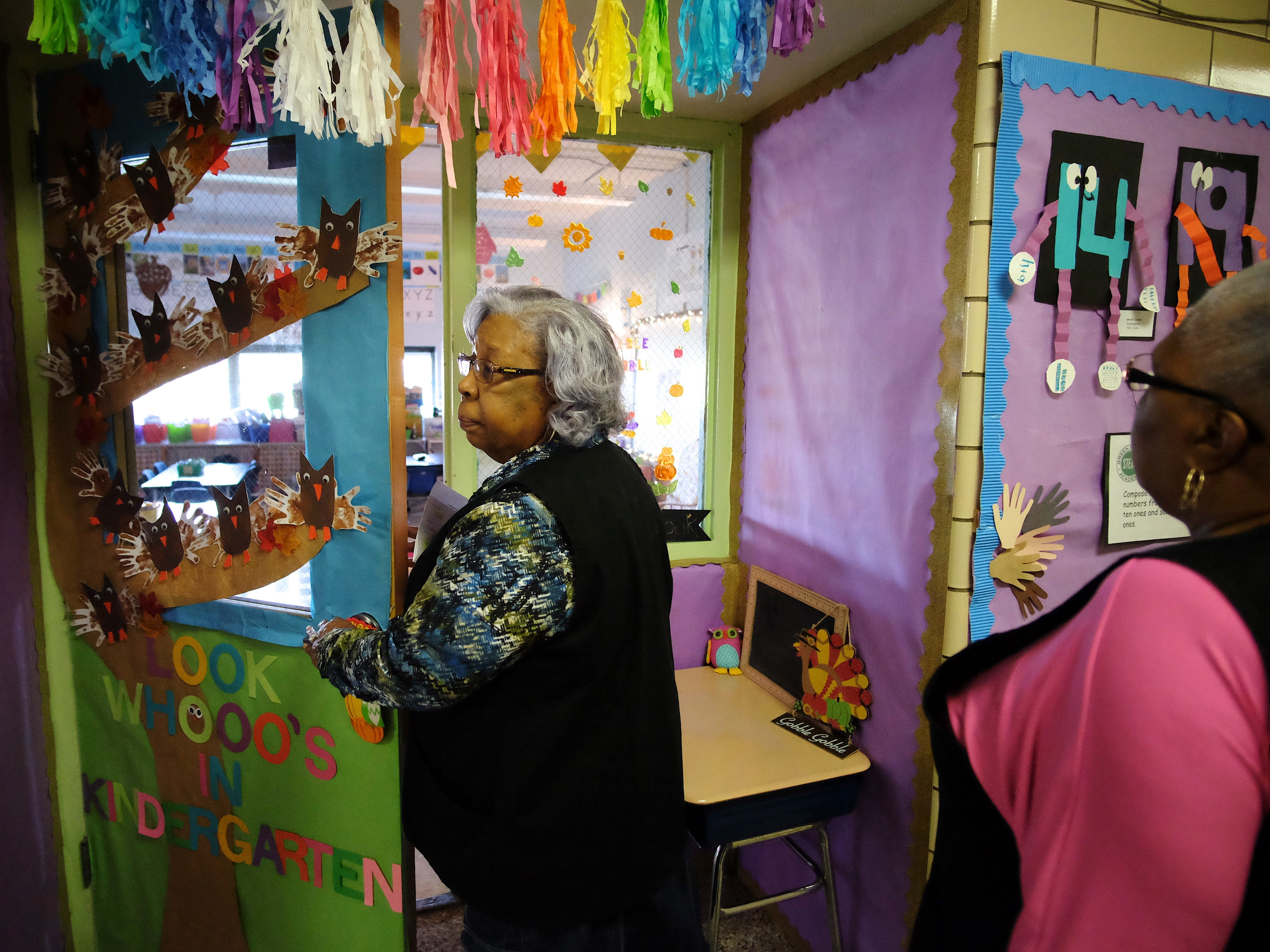 Foster Grandparents Hattie Crockett, left, and Lena Morrison enter a classroom at Green Magnet Academy on Wednesday, November 7, 2018 in Knoxville. Crockett and Morrison are sisters and they have been serving as Foster Grandparents for three years in Knoxville.