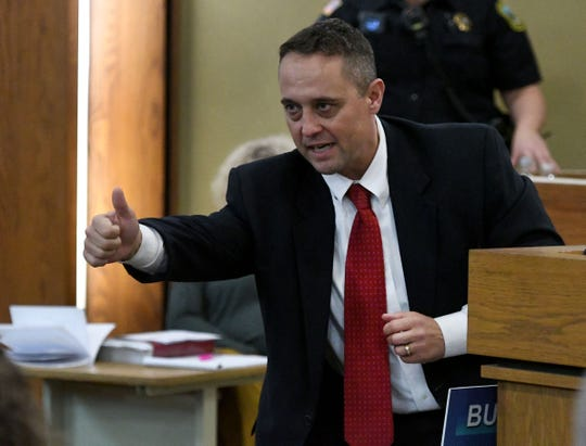 In his closing statement Thursday, Assistant District Attorney General Ron C. Newcomb tells the jury pulling a cellphone from your back pocket and pointing it at an officer is assault.