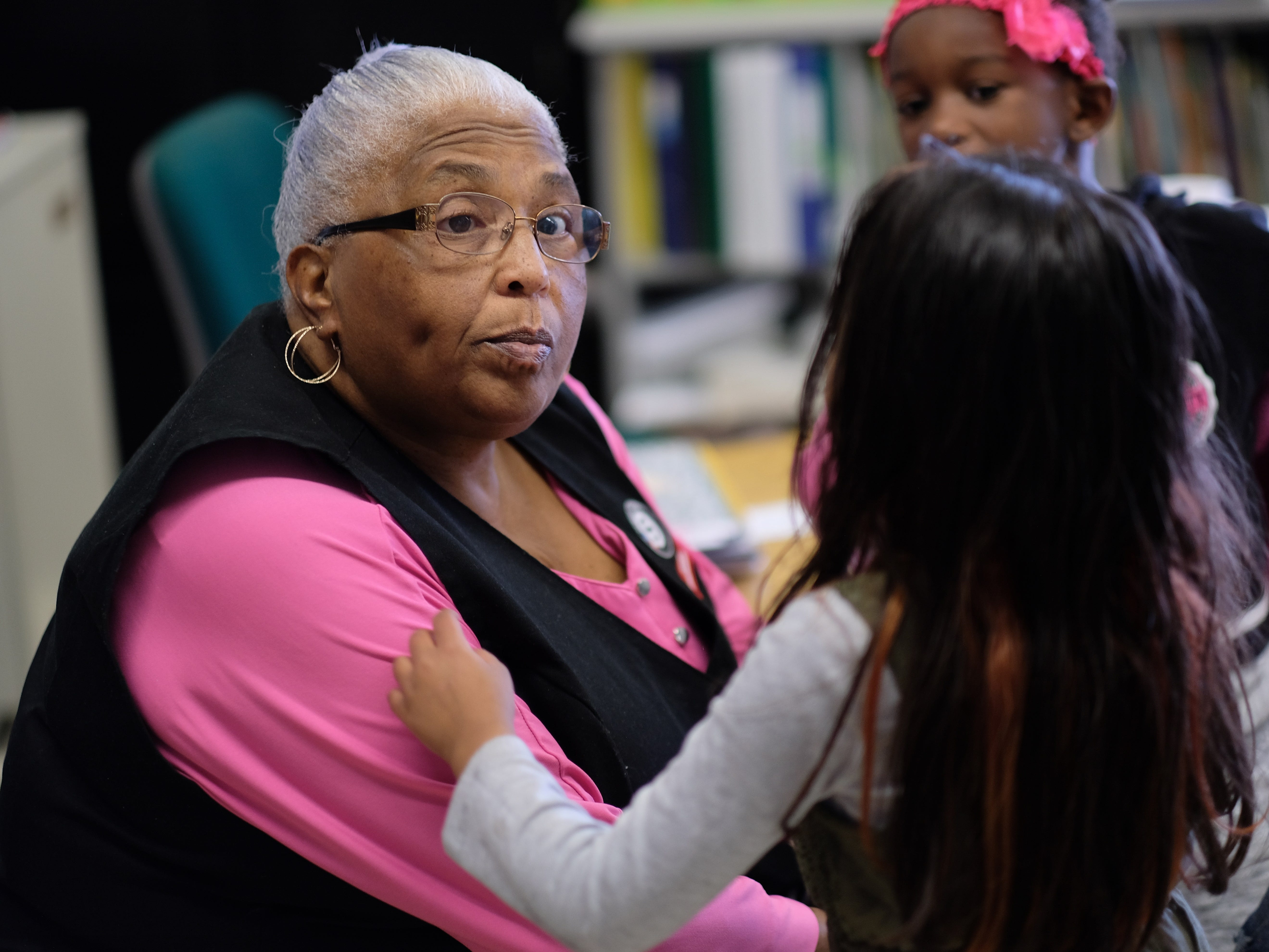 Foster Grandparent Lena Morrison attends to kindergartners during class at Green Magnet Academy on Wednesday, November 7, 2018 in Knoxville. Morrison has been serving as a Foster Grandparent along with her sister Hattie Crockett for three years in Knoxville.