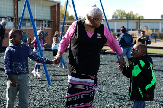 Foster Grandparent Lena Morrison holds hands with kindergartners Mackenzie Mitchell, left, and Joseph Wannamaker during recess at Green Magnet Academy on Wednesday, November 7, 2018 in Knoxville. Morrison has been serving as a Foster Grandparent along with her sister Hattie Crockett for three years in Knoxville.