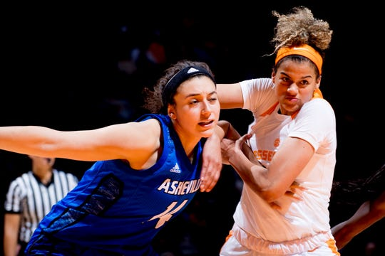 Tennessee guard/forward Rae Burrell (12)  and UNC Asheville  center Brooke Jordan-Brown (14) push each other during a game between Tennessee and UNC Asheville at Thompson-Boling Arena in Knoxville, Tennessee on Wednesday, November 14, 2018.
