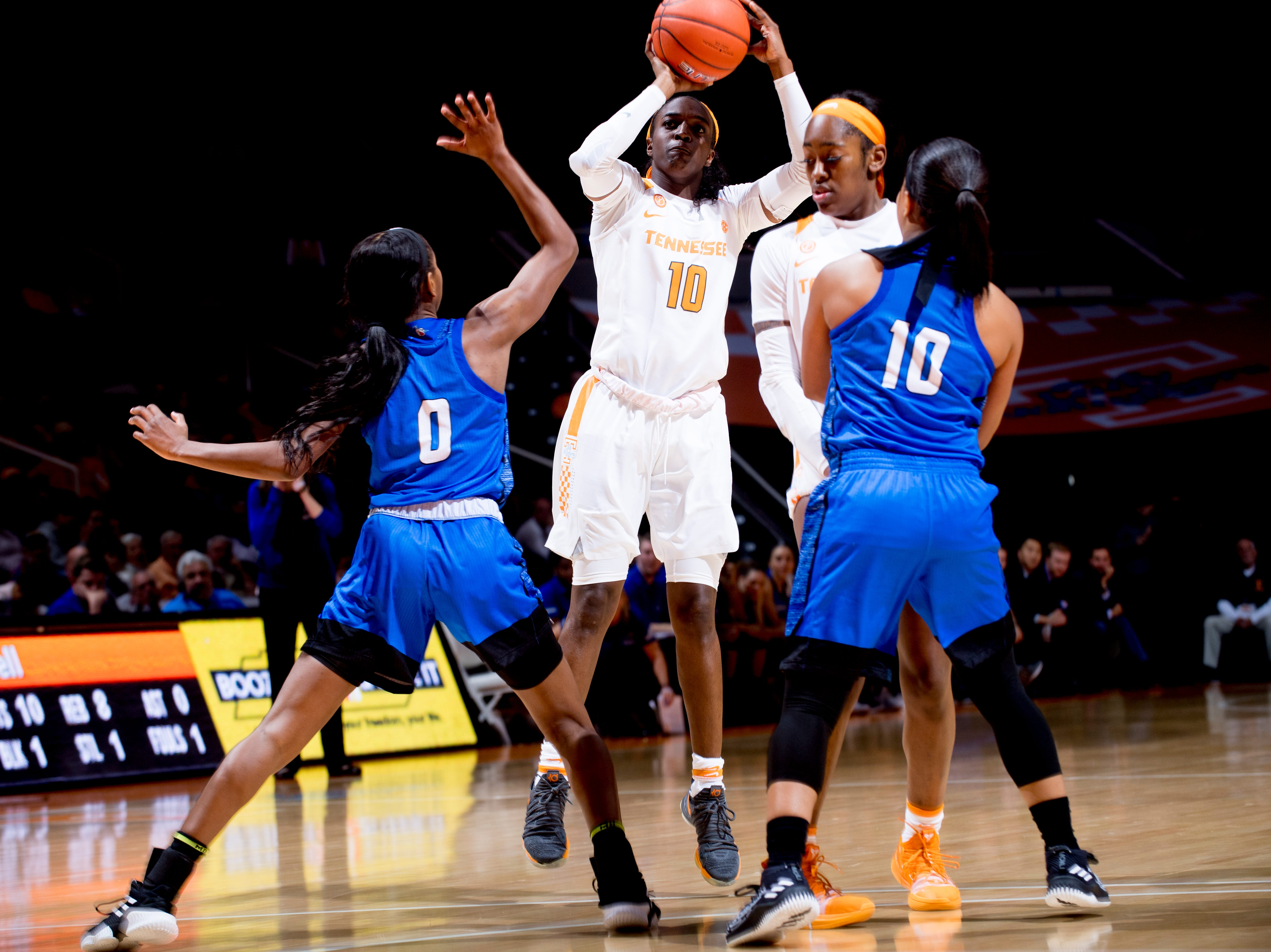 Tennessee guard/forward Meme Jackson (10) shoots past UNC Asheville  guard Nadiria Evans (0) and UNC Asheville  guard Jessica Wall (10) during a game between Tennessee and UNC Asheville at Thompson-Boling Arena in Knoxville, Tennessee on Wednesday, November 14, 2018.