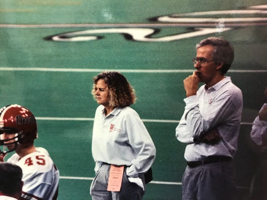 Marion Vruggink and Dr. Robert Hagen watch the 1993 Class 2A state championship game from the sideline.