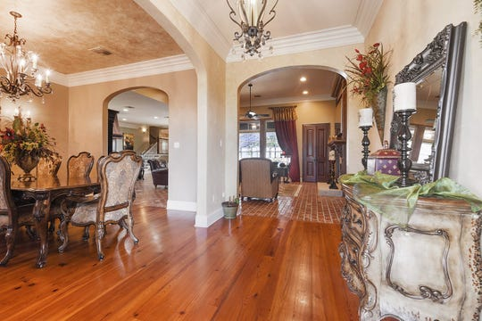 There are gorgeous wood floors and trim throughout the home.