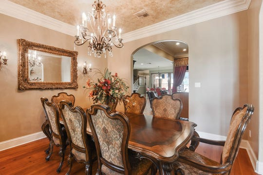 The formal dining room is grand in every respect.