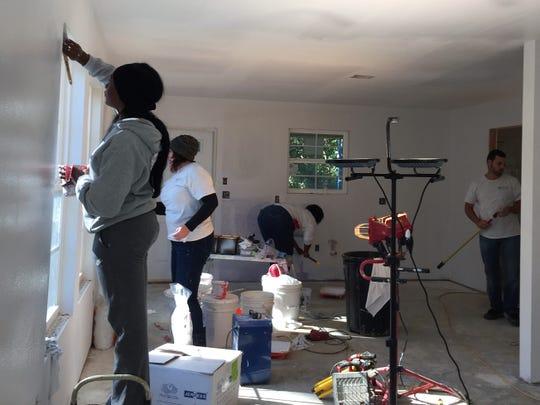 Work goes on inside a Habitat for Humanity house in Lafayette, Louisiana, Nov. 15, 2018.