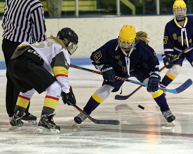 Erika Beauchamp (left) takes the opening faceoff for the Livingston United hockey team in its debut against Grosse Pointe South on Wednesday, Nov. 14, 2018.