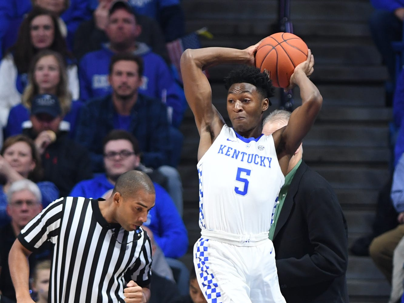UK G Immanuel Quickley saves the ball from going out of bounds during the University of Kentucky mens basketball game against North Dakota at Rupp Arena in Lexington, Kentucky on Wednesday, November 14, 2018.