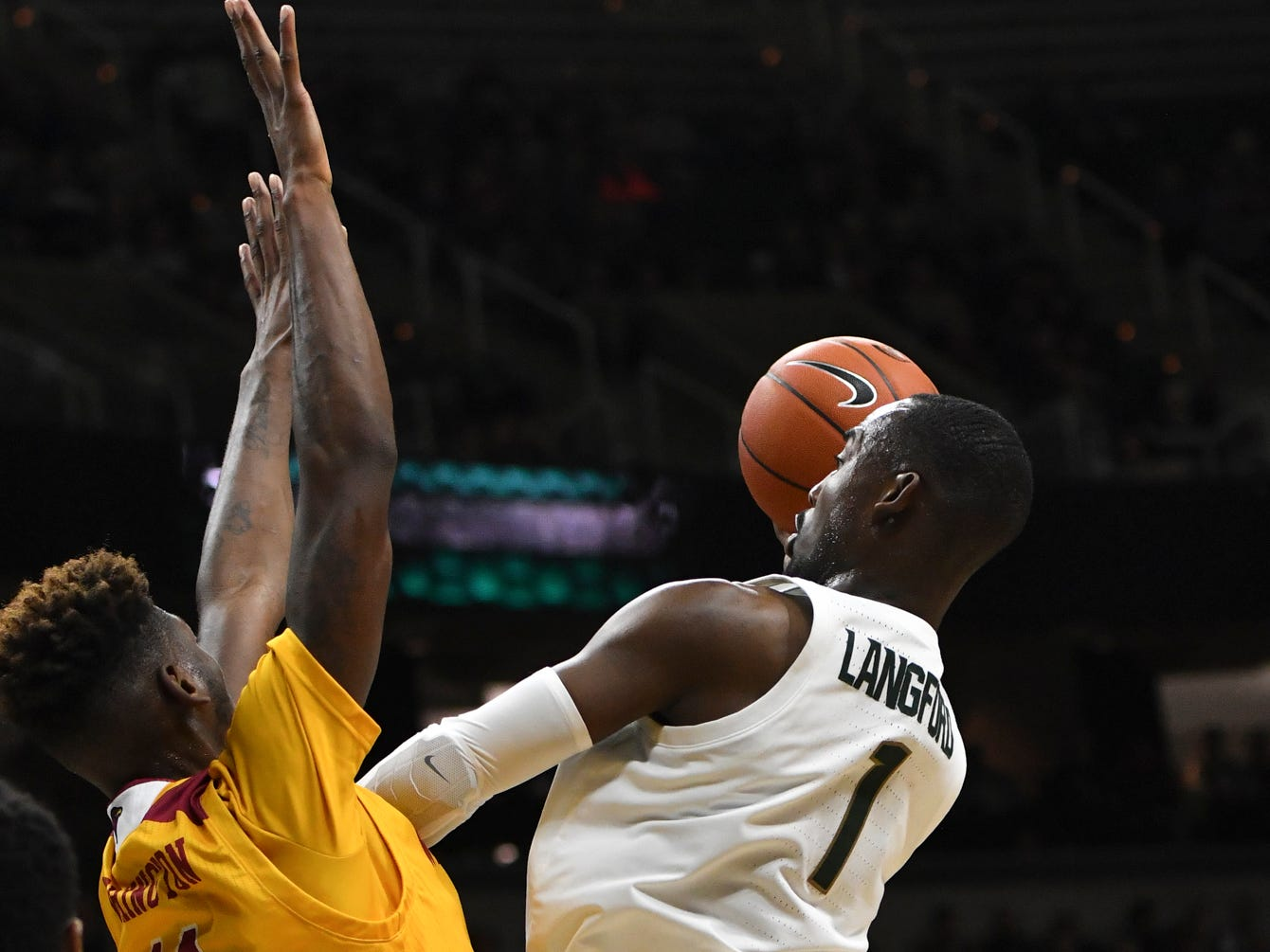 MSU's Joshua Langford shoots against Louisiana-Monroe's Andre Washington Wednesday, Nov. 14, 2018, at the Breslin Center.  MSU won 80-59.