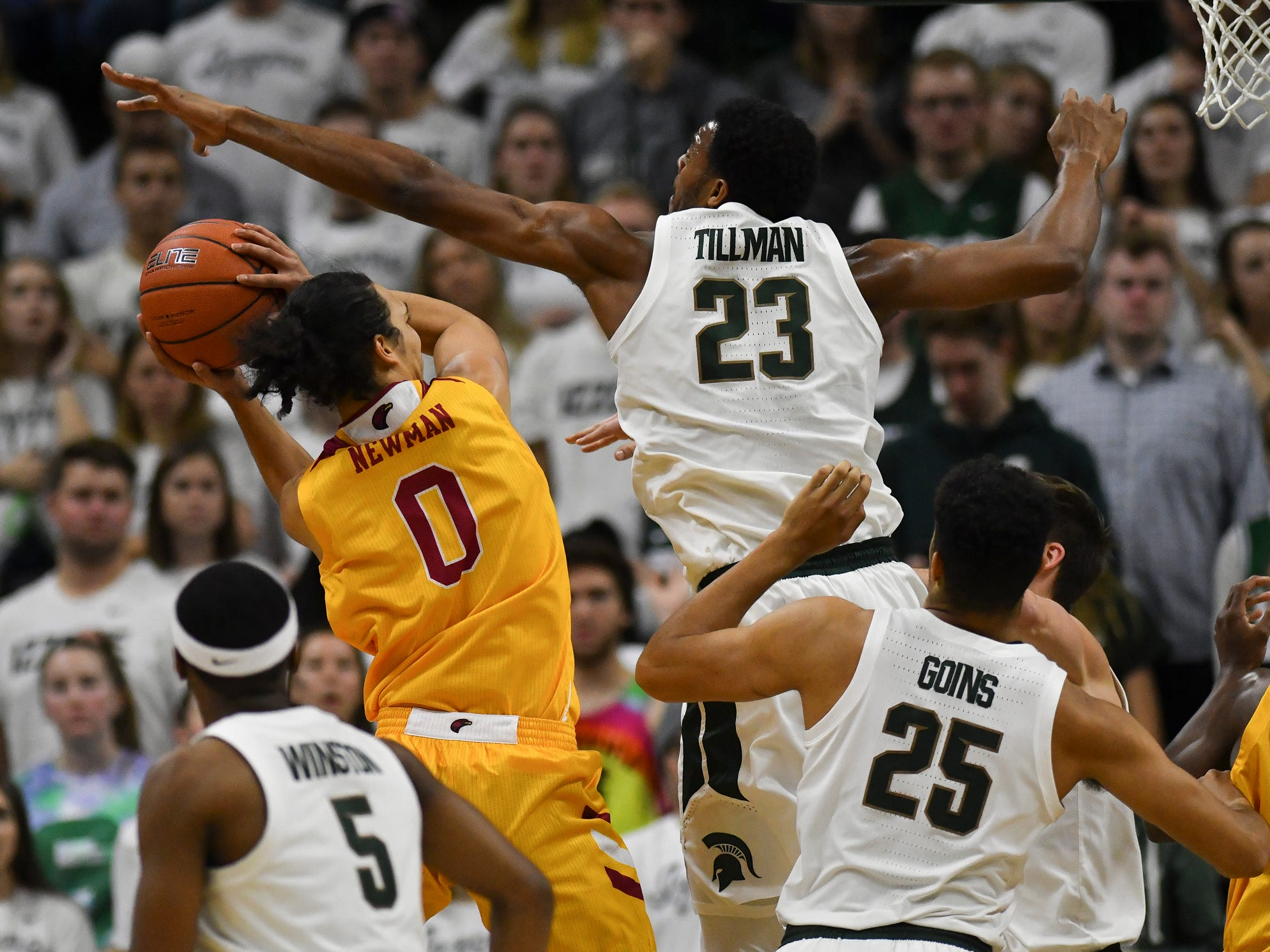 Xavier Tillman heads in to block ULM senior Brandon Newman's shot Wednesday, Nov. 14, 2018, at the Breslin Center.  MSU won 80-59.