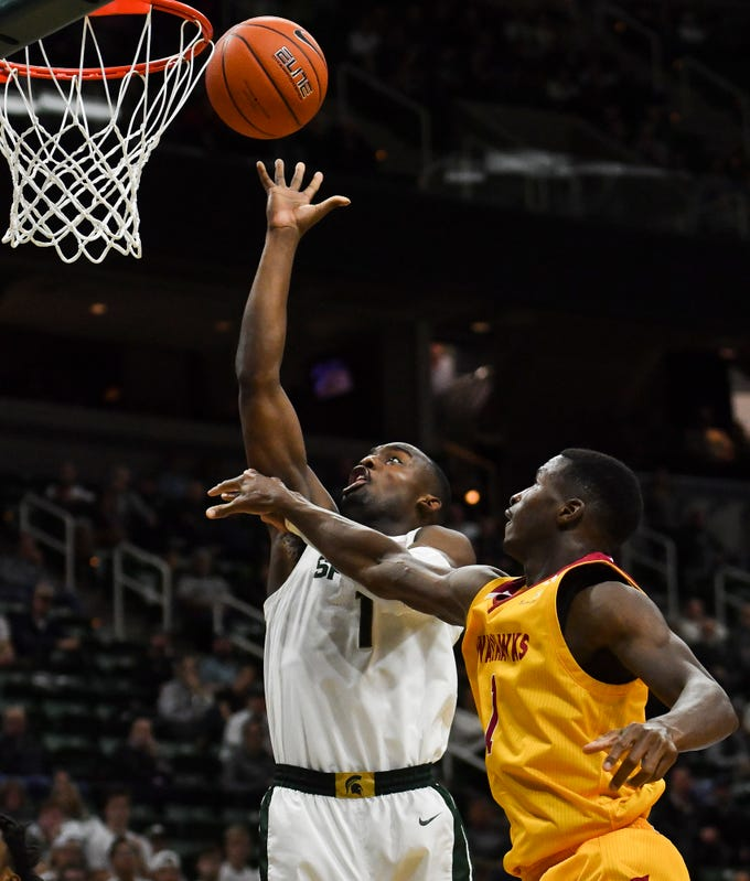 Joshua Langford works under the basket against Travis Munnings of Louisiana-Monroe Wednesday, Nov. 14, 2018, at the Breslin Center.  MSU won 80-59.