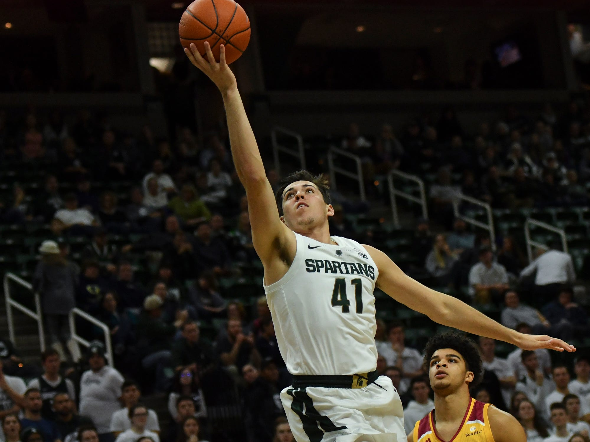 MSU's Conner George scores against Louisiana-Monroe Wednesday, Nov. 14, 2018, at the Breslin Center.  MSU won 80-59.
