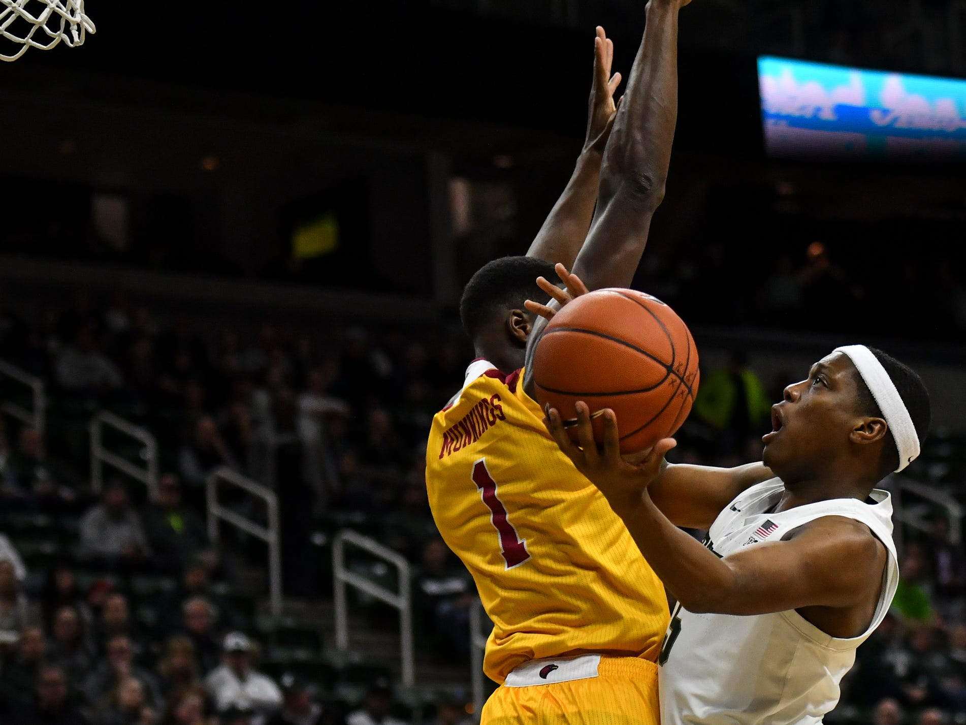 Cassius Winston, right, of MSU drops in two against Louisiana-Monroe's Travis Munnings Wednesday, Nov. 14, 2018, at the Breslin Center.  MSU won 80-59.