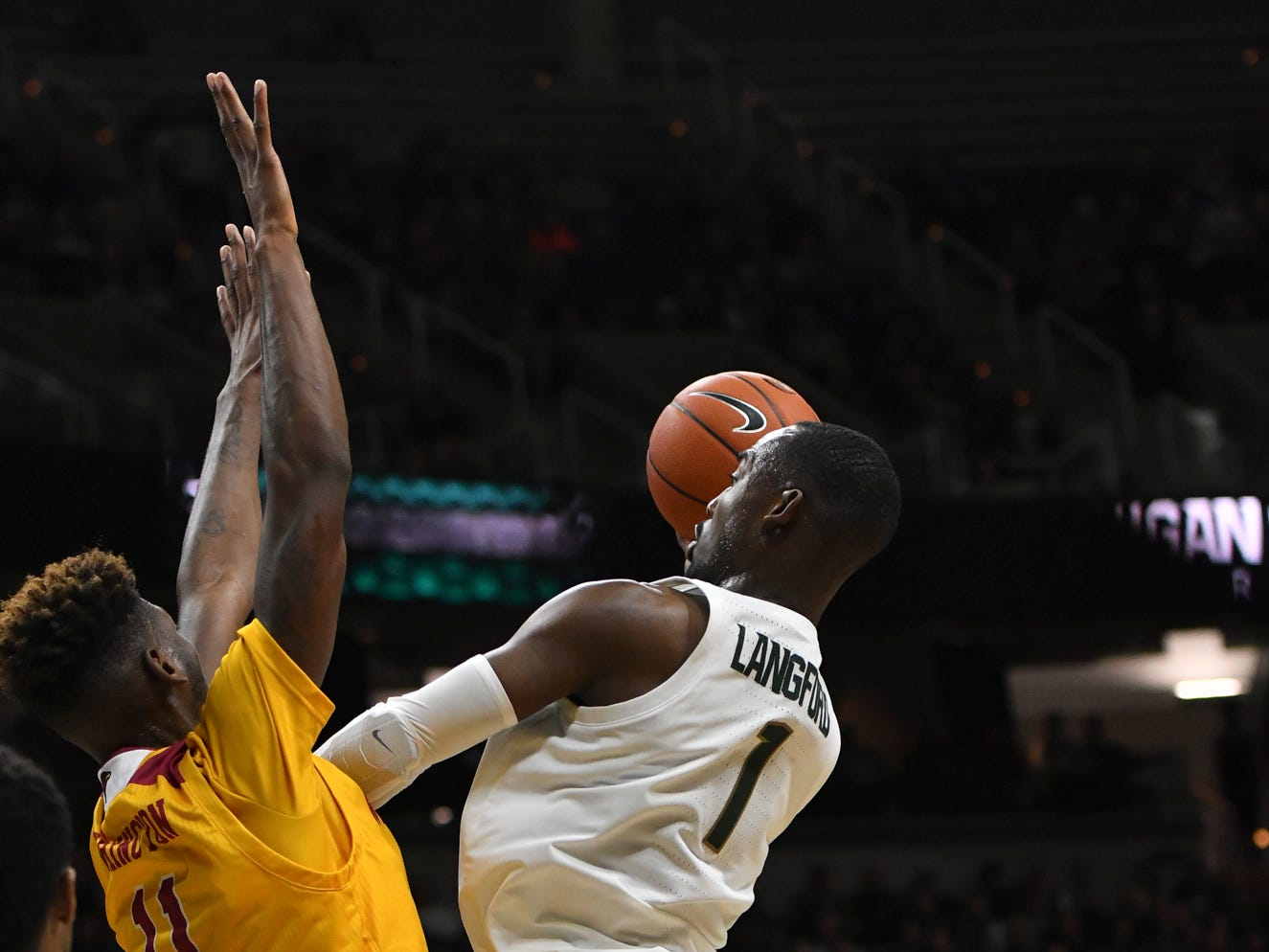 MSU's Jeremy Langford works the paint against ULM's Andre Washington, Wednesday, Nov. 14, 2018, in the Breslin Center.
