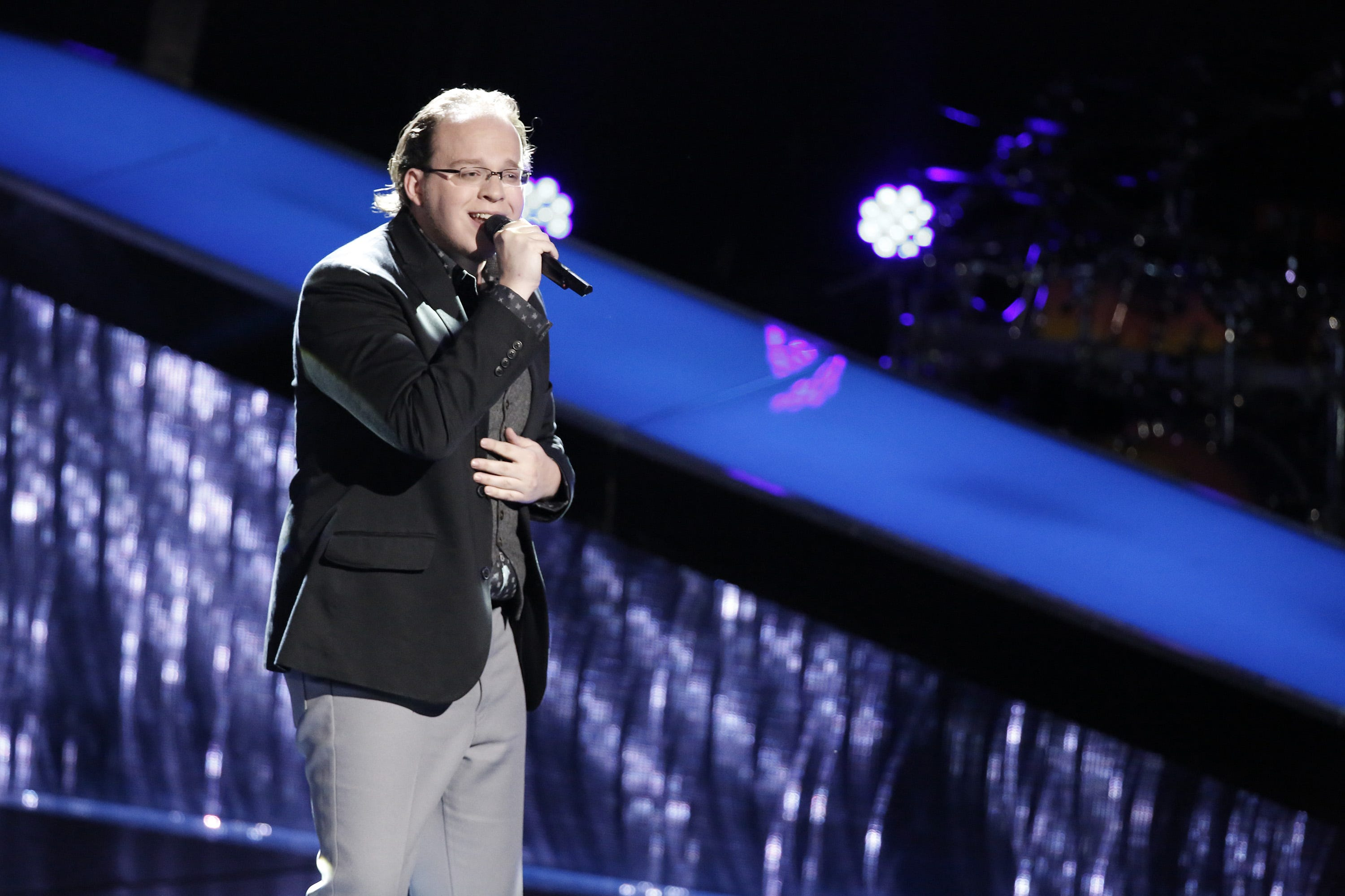 "Lucas Holliday, 28, of Lansing, was known as ""the singing cashier"" when he appeared on NBC's ""The Voice."""