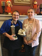 Anissa Krall (left), Service Excellence Award winner, and Dani Schmidt, culinary services manager, at Felician Village in Manitowoc.