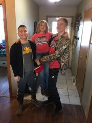 Morgan Gorst is pictured with his sister Ari and brother Will. Morgan, 13, who was diagnosed with glioblastoma in September 2018, died Tuesday.