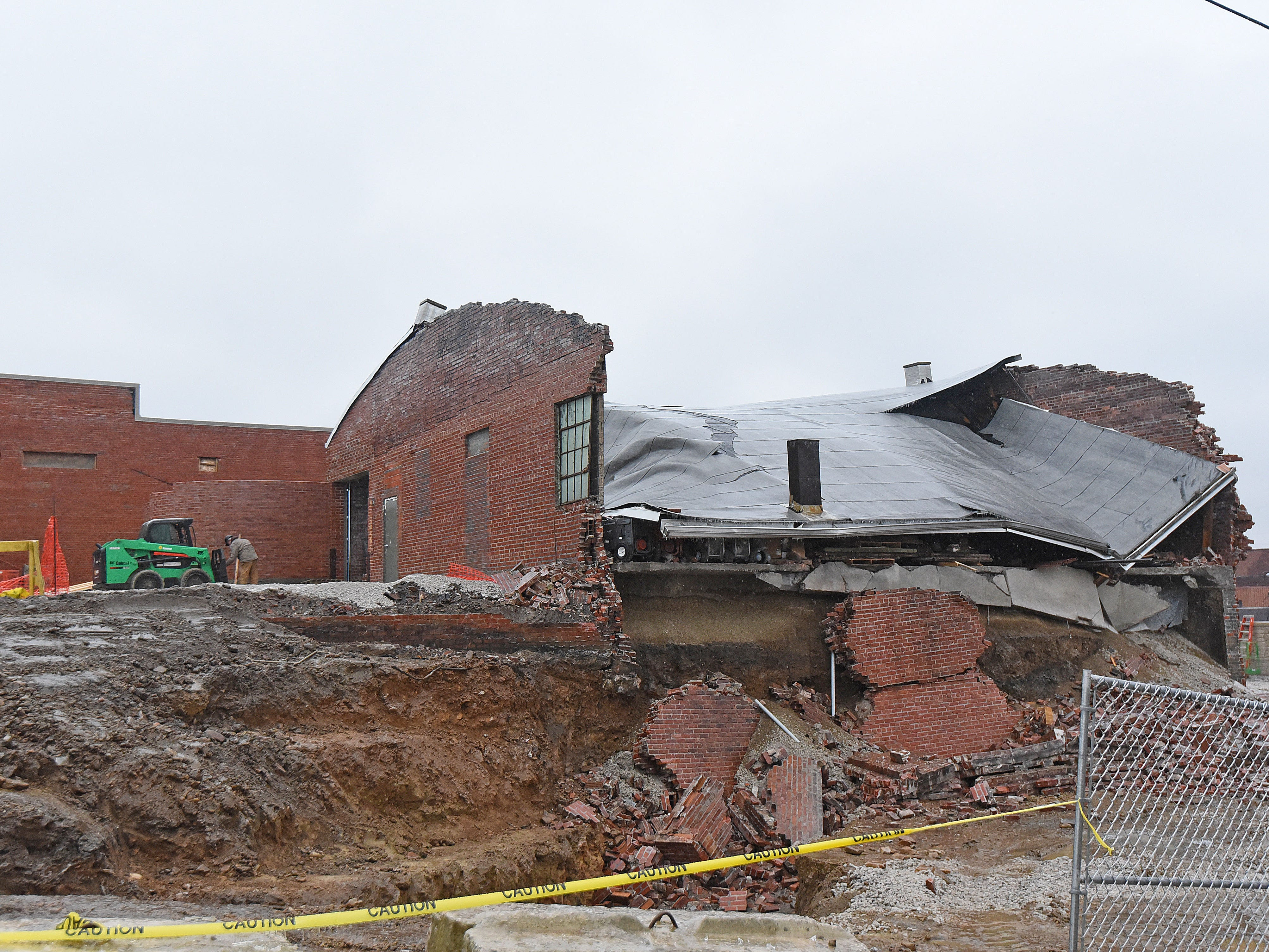 Storage building wall collapses at downtown work site
