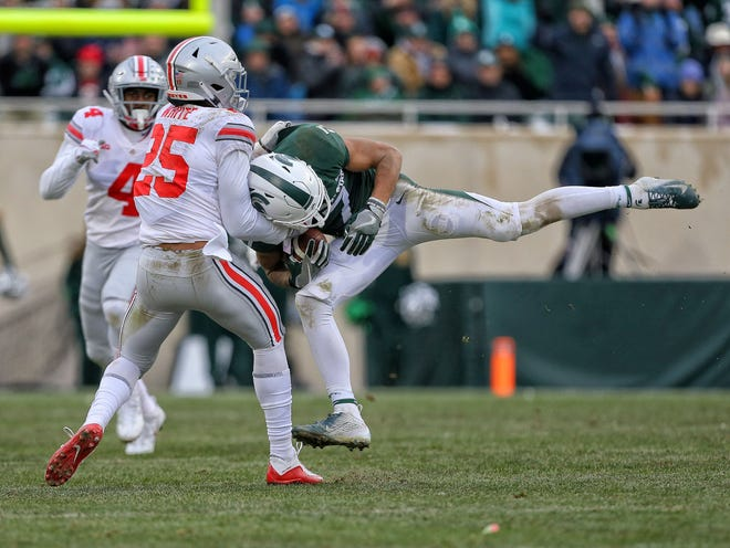 Ohio State safety Brendon White makes a tackle in his first start for the Buckeyes last week at Michigan State.
